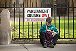 "A protester sits down in Parliament Square during the ""Put it to the People"" rally which made it's way through central London today. Demonstrators from across the country gathered to call for a second referendum on Brexit and to march through the UK capital finishing with speeches in Parliament Square opposite the Houses of Parliament in Westminster."