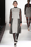 Model walks runway in an outfit from the Emily Daccarett Fall Winter 2015 Noir Collection, during the Emerging Designers Fall Winter 2015 fashion show for  Fashion Gallery New York Fashion Week Fall 2015.