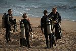 Dive guide doing dive brief before shore dive at ulua beach maui hawaii.