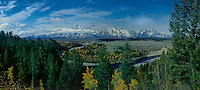 937000019 clouds from a clearing fall storm frame the teton range with fall colored aspens and the snake river in the foreground in this panoramic view from the snake river overlook in grand tetons national park wyoming