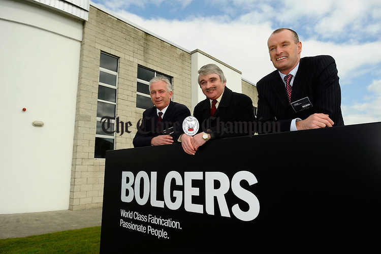 Minister Willie O Dea,  with Graham and Ian Bolger, joint managing directors of Bolgers, Smithstown, Shannon, at the presentation of the Silver Certificate for Caterpillar's Supplier Quality Excellence Process to the company. Photograph by John Kelly.