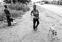 A boy brings his dog for treatment to a mobile CLAW clinic in Snake Park, South Africa. IFAW's CLAW program provides veterinary services to cats and dogs in some of the poorest shantytowns outside of Johannesburg, South Africa. 2/27/12 Julia Cumes/IFAW