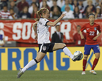 USWNT defender Becky Sauerbrunn  (4) controls the ball. In an international friendly, the U.S. Women's National Team (USWNT) (white/blue) defeated Korea Republic (South Korea) (red/blue), 4-1, at Gillette Stadium on June 15, 2013.