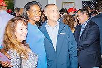 Former 2016 Trump campaign manager and current 2020 Trump campaign senior advisor Corey Lewandowski (center) poses for a picture with write-in Republican candidate for Massachusetts' 7th congressional district Rayla Campbell as he greets people after speaking about the ongoing campaign at a Trump campaign office opening party in Salem, New Hampshire, on Fri., Sept. 18, 2020. Lewandowski lives in nearby Windham, NH, and attended the party which also served as a surprise birthday party for him. Campbell has been petitioning the Massachusetts government to get on the ballot for the 2020 election in a bid to unseat unopposed incumbent Ayanna Pressley (D, MA-7th).