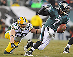 Green Bay Packers linebacker A.J. Hawk (50) dives to try and catch quarterback Michael Vick of the Philadelphia Eagles during the fourth quarter of the Wild Card round playoff game at Lincoln Financial Field in Philadelphia, Penn., on Sunday, Jan. 9, 2011.