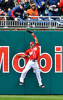 2 April 2011: Washington Nationals outfielder Michael Morse is unable to come up with a Dan Uggla blast for a home run for the Atlanta Braves at Nationals Park in Washington, District of Columbia. The Nationals defeated the Braves 6-3 in the second game of their season opening series. Mandatory Credit: Ed Wolfstein Photo
