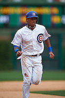 Chicago Cubs shortstop Addison Russell (22) runs the bases on a Dexter Fowler (not pictured) home run during a game against the Milwaukee Brewers on August 13, 2015 at Wrigley Field in Chicago, Illinois.  Chicago defeated Milwaukee 9-2.  (Mike Janes/Four Seam Images)