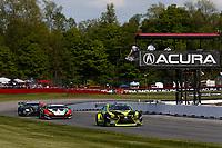 #12: VasserSullivan Lexus RC F GT3, GTD: Frankie Montecalvo, Zach Veach crosses the finish line under the checkered flag