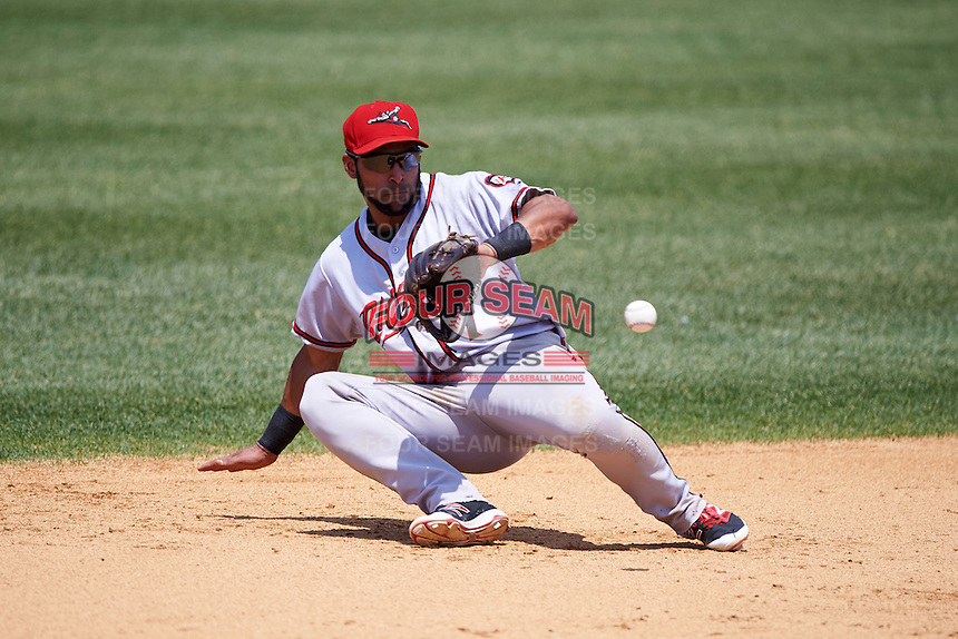 Richmond Flying Squirrels shortstop Ali Castillo (7) fields a ground ball during a game against the Binghamton Mets on June 26, 2016 at NYSEG Stadium in Binghamton, New York.  Binghamton defeated Richmond 7-2.  (Mike Janes/Four Seam Images)