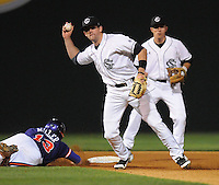 Second baseman Scott Wingo (8) of the South Carolina Gamecocks turns a double play, putting out Brad Miller (13) of the Clemson Tigers in the fourth inning on Tuesday, March 8, 2011, at Fluor Field in Greenville, S.C. South Carolina won 5-4. Photo by Tom Priddy / Four Seam Images