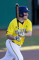 Michigan Wolverines designated hitter Kyle Jusick (34) follows through on his swing during the NCAA season opening baseball game against the Texas State Bobcats on February 14, 2014 at Bobcat Ballpark in San Marcos, Texas. Texas State defeated Michigan 8-7 in 10 innings. (Andrew Woolley/Four Seam Images)