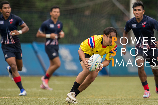Rujipas Tumtamala of Thailand in action against Malaysia's players during the match between Malaysia and Thailand of the Asia Rugby U20 Sevens Series 2016 on 12 August 2016 at the King's Park, in Hong Kong, China. Photo by Marcio Machado / Power Sport Images