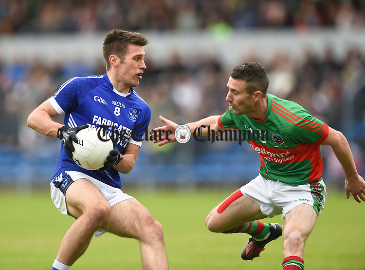 Conor Ryan of  Cratloe in action against Shane Hickey of Kilmurry Ibrickane during their senior football final replay at Cusack park. Photograph by John Kelly.