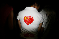CHINA. Beijing. The back of a woman on Tiananmen Square during the Beijing 2008 Summer Olympics. 2008