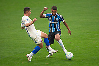 13th September 2020; Arena do Gremio Stadium, Porto Alegre, Brazil; Brazilian Serie A, Gremio versus Fortaleza; Alisson of Gremio tackled by Osvaldo of Fortaleza