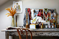 Lonika Chande's home workspace is a distressed country table and a notice board for inspiration