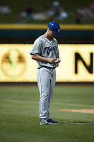 Asheville Tourists manager Nate Shaver (25) updates his lineup card during the game against the Winston-Salem Dash at Truist Stadium on September 17, 2021 in Winston-Salem, North Carolina. (Brian Westerholt/Four Seam Images)