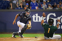 Wilmington Blue Rocks catcher Chad Johnson (7) looks to tag  Juan De La Cruz (1) sliding into home during a game against the Lynchburg Hillcats on June 3, 2016 at Judy Johnson Field at Daniel S. Frawley Stadium in Wilmington, Delaware.  Lynchburg defeated Wilmington 16-11 in ten innings.  (Mike Janes/Four Seam Images)