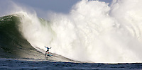 Half Moon Bay, California - January 24, 2014: 2014 Maverick's Invitational Peter Mel in front of a white water explosion.