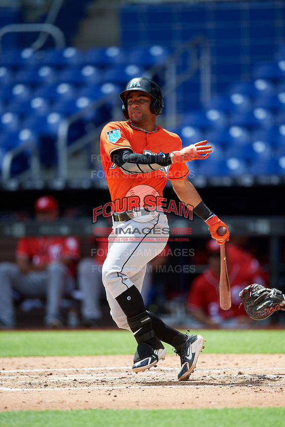 Miami Marlins James Nelson (67) follows through on a swing during a Florida Instructional League game against the Washington Nationals on September 26, 2018 at the Marlins Park in Miami, Florida.  (Mike Janes/Four Seam Images)