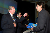 """Montreal, April 4rd 2001<br /> Charles G"""" Cavell,Quebecor World President and CEO (left)  speaks with Quebecor Vice-Chairman of the Board : Erik Peladeau at <br /> Quebecor World annual meeting, April 4th 2001, in Montreal, CANADA<br /> Since the `` Merger of equals `` between Quebecor Printing and World Color, the company operating margin reached a record high of 11.1 % for the year ; revenues increased by 32 % to 6.5 billion US $ ; operating income increased by 53 % to 724.8 Million US $  and net income increased by 43 % to 293.4 Million US $, or 1,93 US $ per share.<br /> Quebecor World is now the largest and strongest performing entity in the printing field<br /> Photo by Pierre Roussel/  Liaison<br /> NOTE :  D-1 photo uncorrected"""
