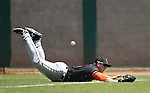 Fresno Grizzlies' Jon Kemmer dives for a hit down the firstbase line in a game against the Reno Aces at Greater Nevada Field in Reno, Nev., on Tuesday, April 26, 2016. <br />