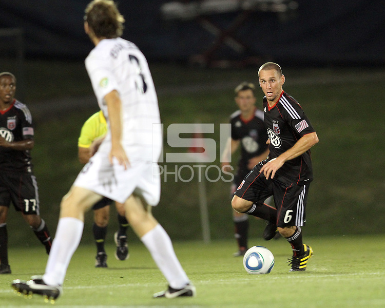 Kurt Morsink #6 of D.C. United moves up on Dustin Bixler #3 of the Harrisburg City Islanders during a US Open Cup match at the Maryland Soccerplex on July 21 2010, in Boyds, Maryland. United won 2-0.