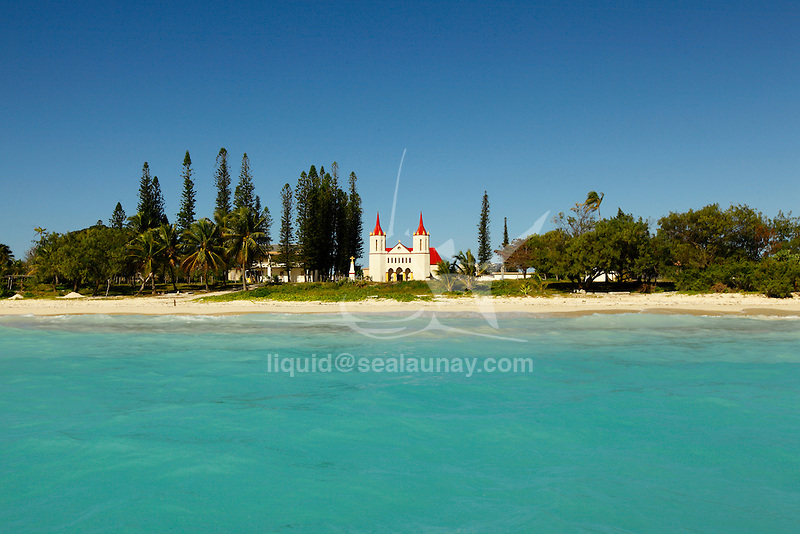 """View from the lagoon of the Fayaoue Catholic church on the ouvea island in the Loyalty islands..Ouvéa (local pronunciation: [u?ve.a]) is a commune in the Loyalty Islands Province of New Caledonia, an overseas territory of France in the Pacific Ocean. The settlement of Fayaoué [fa?jawe], on Ouvéa Island, is the administrative centre of the commune of Ouvéa..Ouvéa is made up of Ouvéa Island, the smaller Mouli Island and Faiava Island, and several islets around these three islands. All these lie among the Loyalty Islands, to the northeast of New Caledonia's mainland..Ouvéa Island is one of the Loyalty Islands, in the archipelago of New Caledonia, an overseas territory of France in the Pacific Ocean. The island is part of the commune (municipality) of Ouvéa, in the Islands Province of New Caledonia..The crescent-shaped island, which belongs to a larger atoll, is 50 km (30 miles) long and 7 km (4.5 miles) wide. It lies northeast of Grande Terre, New Caledonia's mainland..Ouvéa is home to around 3,000 people that are organized into tribes divided into Polenesian, Melanesian and Walisian by ethnic descend. The Iaai language is spoken on the island..The two native languages of Ouvéa are the Melanesian Iaai and the Polynesian Faga Uvea, which is the only Polynesian language that has taken root in New Caledonia. Speakers of Faga Uvea have fully integrated into the Kanak society, and consider themselves Kanak..Ouvéa has rich marine resources and is home to many sea turtles, species of fish, coral as well as a native parrot, the Uvea Parakeet, that can only be found on the island of Ouvéa..A large crustacaen called a """"coconut crab"""" or crabe de cocotier can also be found on the islands. The large crabs live in palm tree plantations and live solely on a diet of coconuts that they crack open with their powerful claws. They are blue in colour and can grow to several kilos in size. They are a land based species and do not venture into the ocean..Ouvéa is also home to trophy Bonefish"""