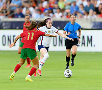 HOUSTON, TX - JUNE 10: Rose Lavelle #16 of the United States brings the ball up the field with Tatiana Pinto #11 of Portugal closing in on her during a game between Portugal and USWNT at BBVA Stadium on June 10, 2021 in Houston, Texas.