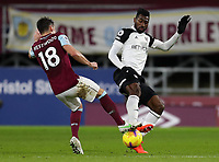17th February 2021; Turf Moor, Burnley, Lanchashire, England; English Premier League Football, Burnley versus Fulham; Andre-Frank Zambo Anguissa of Fulham is tackled by Ashley Westwood of Burnley