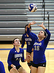 Marymount's Mallory Mitchell sets during a college volleyball match at Washington & Lee University Lexington, Vir., on Saturday, Oct. 5, 2013.<br /> Photo by Cathleen Allison