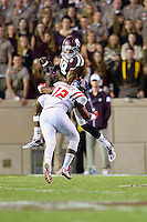 Texas A&M wide receiver Edward Pope (18) is tackled by Ole Miss defensive back Tony Conner (12) during second half of an NCAA football game, Saturday, October 11, 2014 in College Station, Tex. Ole Miss defeated Texas A&M 35-20. (Mo Khursheed/TFV Media via AP Images)
