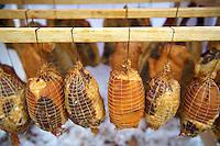 Hungarian Mangalicsa (Mangalitsa) smoked hams pig meat ptoducts. Food photos.