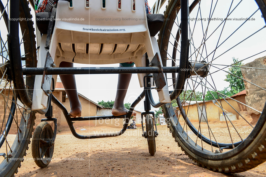 TOGO, Tohoun, village ADJIKAME, young handicapped woman in wheelchair / junge Frau im Rollstuhl
