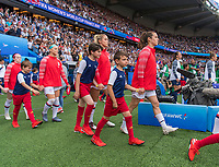 PARIS,  - JUNE 28: Julie Ertz #8, Abby Dahlkemper #7 and Kelley O'Hara #5 enter the field during a game between France and USWNT at Parc des Princes on June 28, 2019 in Paris, France.