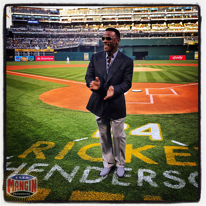 OAKLAND, CA - APRIL 3: iPhone Instagram of Oakland Athletics Hall of Famer Rickey Henderson standing on the field during pregame ceremonies on Opening Night at the Oakland Coliseum on April 3, 2017 in Oakland, California. (Photo by Brad Mangin)