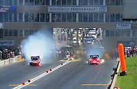 Jul. 23, 2011; Morrison, CO, USA: NHRA funny car driver Melanie Troxel (left) alongside Jeff Diehl during qualifying for the Mile High Nationals at Bandimere Speedway. Mandatory Credit: Mark J. Rebilas-