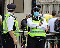 """Extinction Rebellion demonstration<br /> It seemed strange that when a large gathering like a demonstration was held, Police would be in close proximity with protesters but not wearing a face covering. Recently a change in policy has meant that in some situations where social distancing is impossible, they will. A spokesperson said: """"If officers cannot maintain a two metre gap and where there is a possible risk of infection, our policy is now that officers will wear a facemask, which all officers have readily available."""" London on 9th September 2020<br /> CAP/ROS<br /> ©ROS/Capital Pictures"""