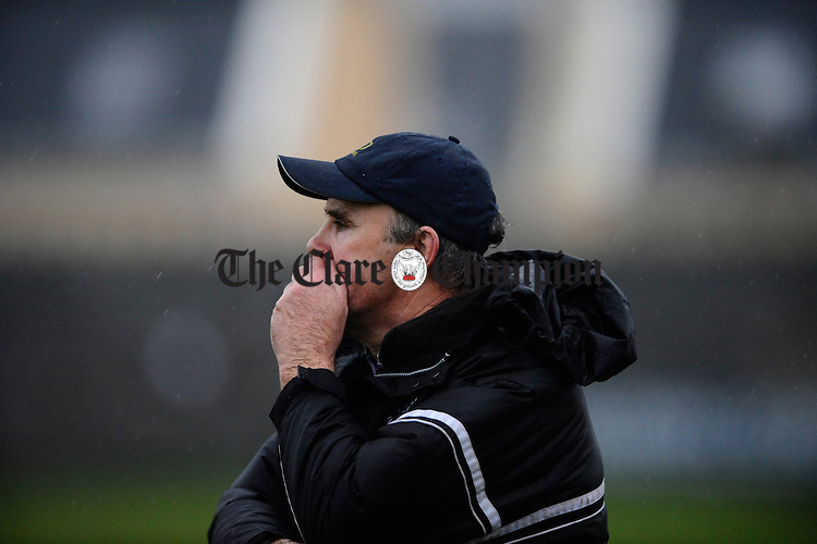 Doonbeg manager Tommy Tubridy looks on as his charges are beaten by Liscannor during their semi final at Miltown Malbay. Photograph  by John Kelly.