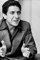 His hair combed back, Greek-style, from his tanned forehead, with a black open-necked shirt under a plain gray suit, Leonard Cohen yesterday talked with Star book editor Roy MacSkimming about Greece, mutual friends and <br /> writing.<br /> <br /> Innell, Reg<br /> Picture, 1975,<br /> <br /> <br /> Toronto Star Archives - AQP