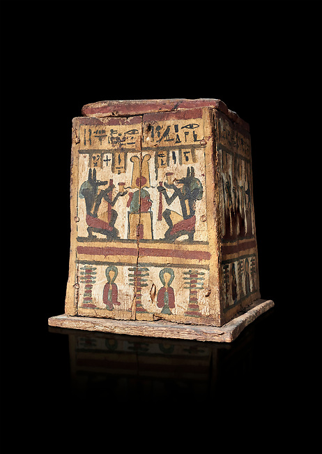 Ancient Egyptian pylon (gateway) shaped Canopic chest for internal organs, wood, Late  to Ptolemaic Period(722-40 BC), Egyptian Museum, Turin. Old Fund Cat 2427.  Black background,<br /> <br /> Canopic chests are cases used by Ancient Egyptians to contain the internal organs removed during the process of mummification.