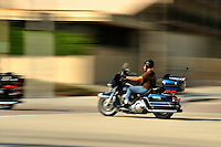 Bike rider cruising down the A1A, Ft Lauderdale