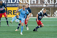 FOXBOROUGH, MA - SEPTEMBER 19: Alexander Ring #8 of New York City FC passes the ball with Thomas McNamara #23 of New England Revolution closing in during a game between New York City FC and New England Revolution at Gillette on September 19, 2020 in Foxborough, Massachusetts.