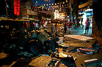 """A day after the most violent clashes between the """"Red Shirts"""" and the military an abandoned Humvee left by the army lies vandalised on a side street where at least three protesters were shot dead. Central Bangkok."""