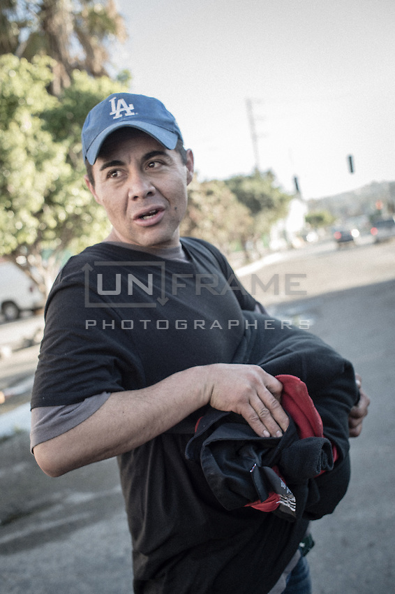 A man who has been deported just a day ago. Fearing to be mugged he carries a bag with all his belongings with him all the time. Tijuana, Mexico. Jan 07, 2015.