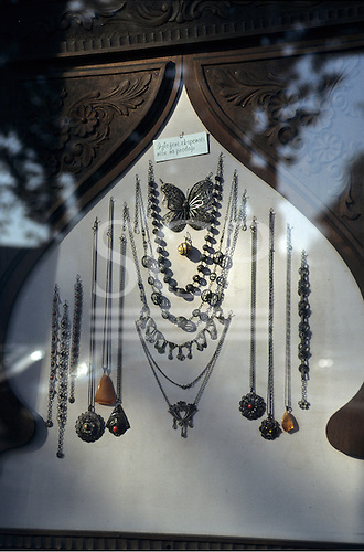 Belgrade, Serbia, Yugoslavia. Amber and silver jewellery displayed with a carved wooden surround in an Arab style.