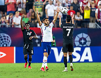 NASHVILLE, TN - SEPTEMBER 5: Cristian Roldan #7 of the United States holds up his hands in front of Stephen Eustaquio #7 of Canada during a game between Canada and USMNT at Nissan Stadium on September 5, 2021 in Nashville, Tennessee.