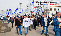 Journal de Quebec newspaper locked out workers walk to the Quebecor owned paper office during a protest for the one-year mark of the lockout in Quebec city April 20, 2007.<br /> <br /> PHOTO :  Francis Vachon - Agence Quebec Presse