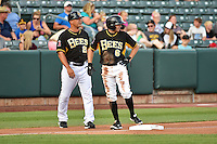Salt Lake Bees manager Keith Johnson (21) talks to Tony Campana (6) during the game against the Reno Aces in Pacific Coast League action at Smith's Ballpark on July 23, 2014 in Salt Lake City, Utah.  (Stephen Smith/Four Seam Images)