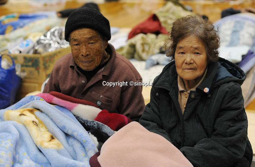 Shikenobu Matsumato, 84 (left) and Horu Matsumato, 77, sheltered at the Azuma Sports Complex. The gymnasiums, workout rooms and hallways of the  Azuma Sports Complex have been designated a shelter at Fukushima City, about 60 km from the Fukushima Daiichi Nuclear Power Plant. Plant was damaged during the  Earthquake and following Tsunami that struck Japan on 11 March 2011..17 Mar 2011..